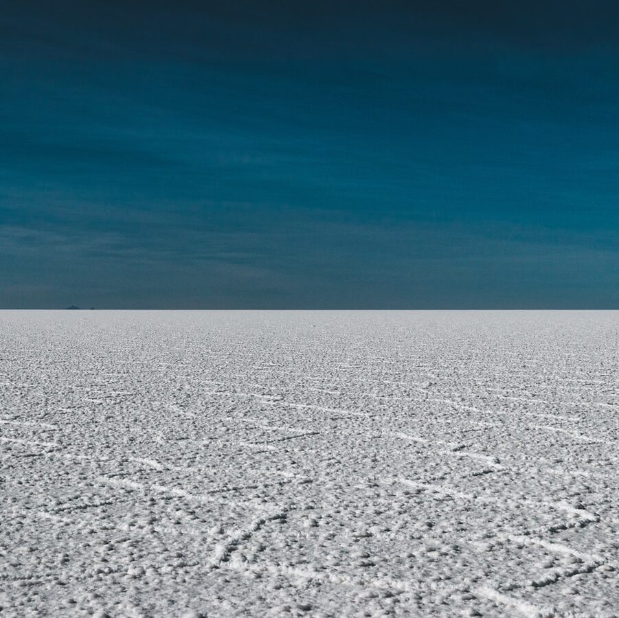 grey soil with deep blue sky in bolivia