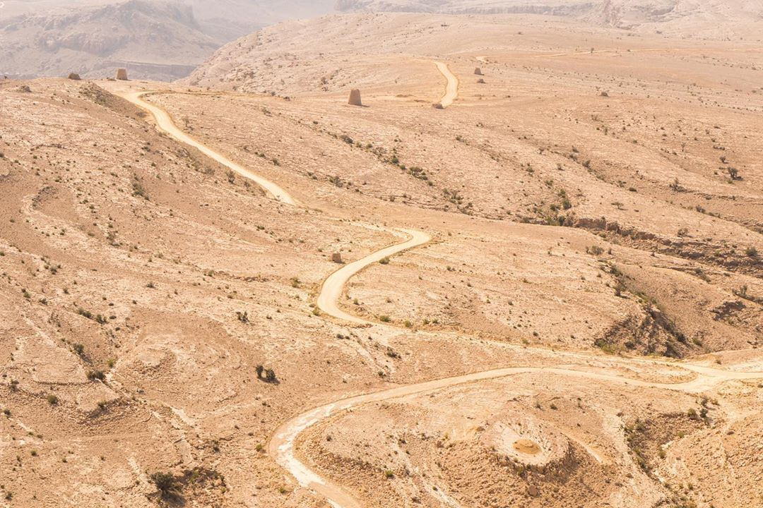sinuous road in the desert in oman