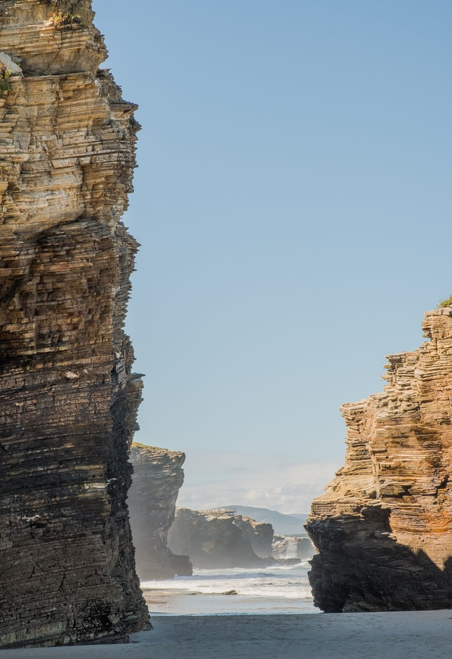 The cliffs of the Cathedral Beach Travel Guide. Picture from Pau Casals