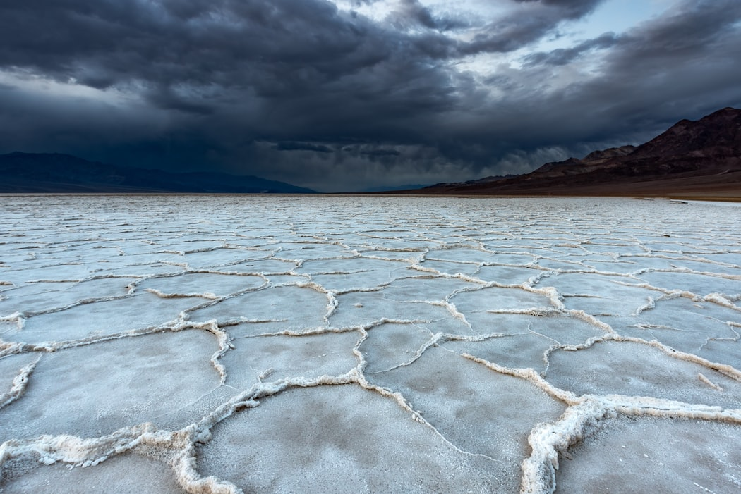 gray soil under stormy sky in death valley