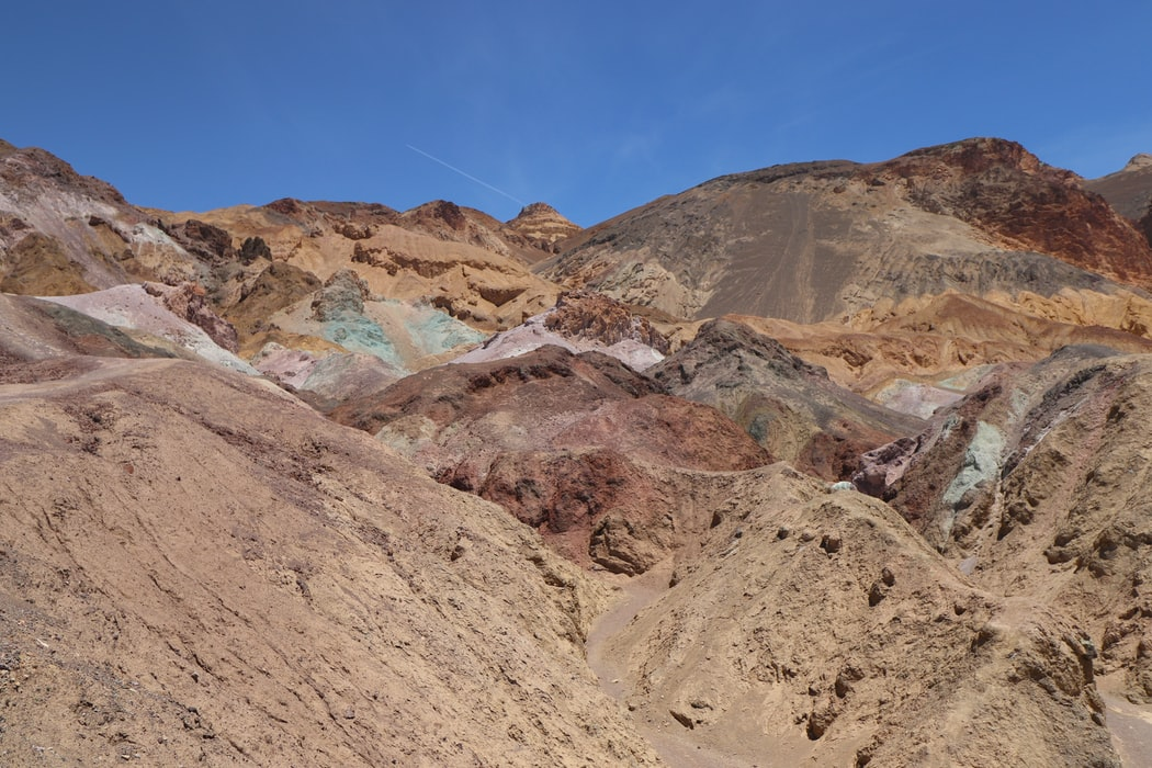 colorful rocky mountain under clear blue sky