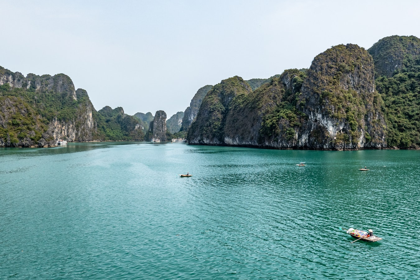 sugar loaves on the flat blue sea in halong bay