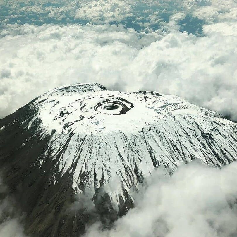 aerial photography of a volcano covered with snow