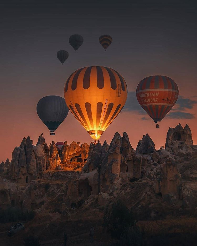 six hot air ballons in the night in cappadocia