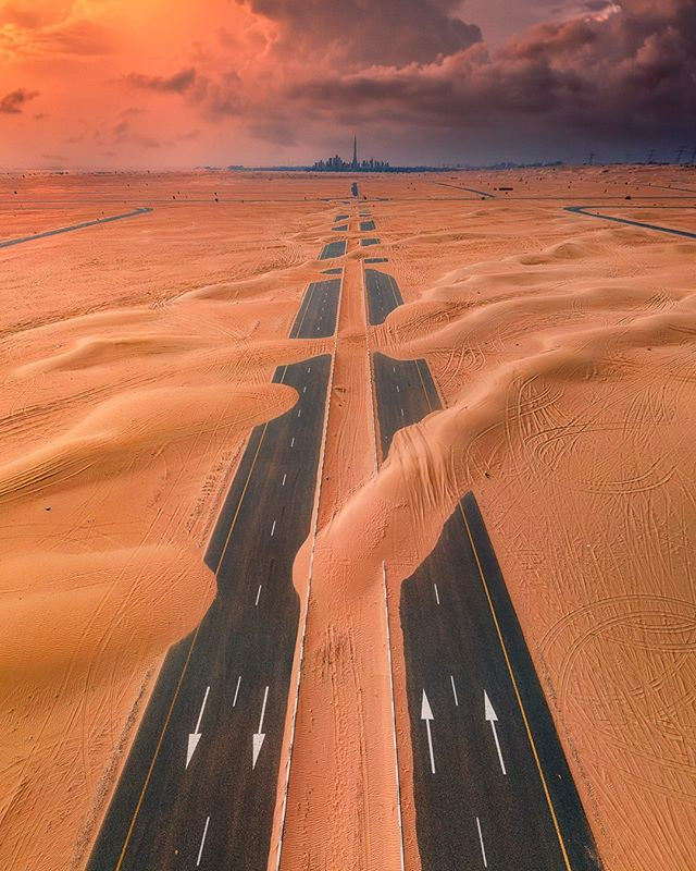 A road covered by the sand outside of Dubai. Picture from Raffaele Cabras @mixyourshot