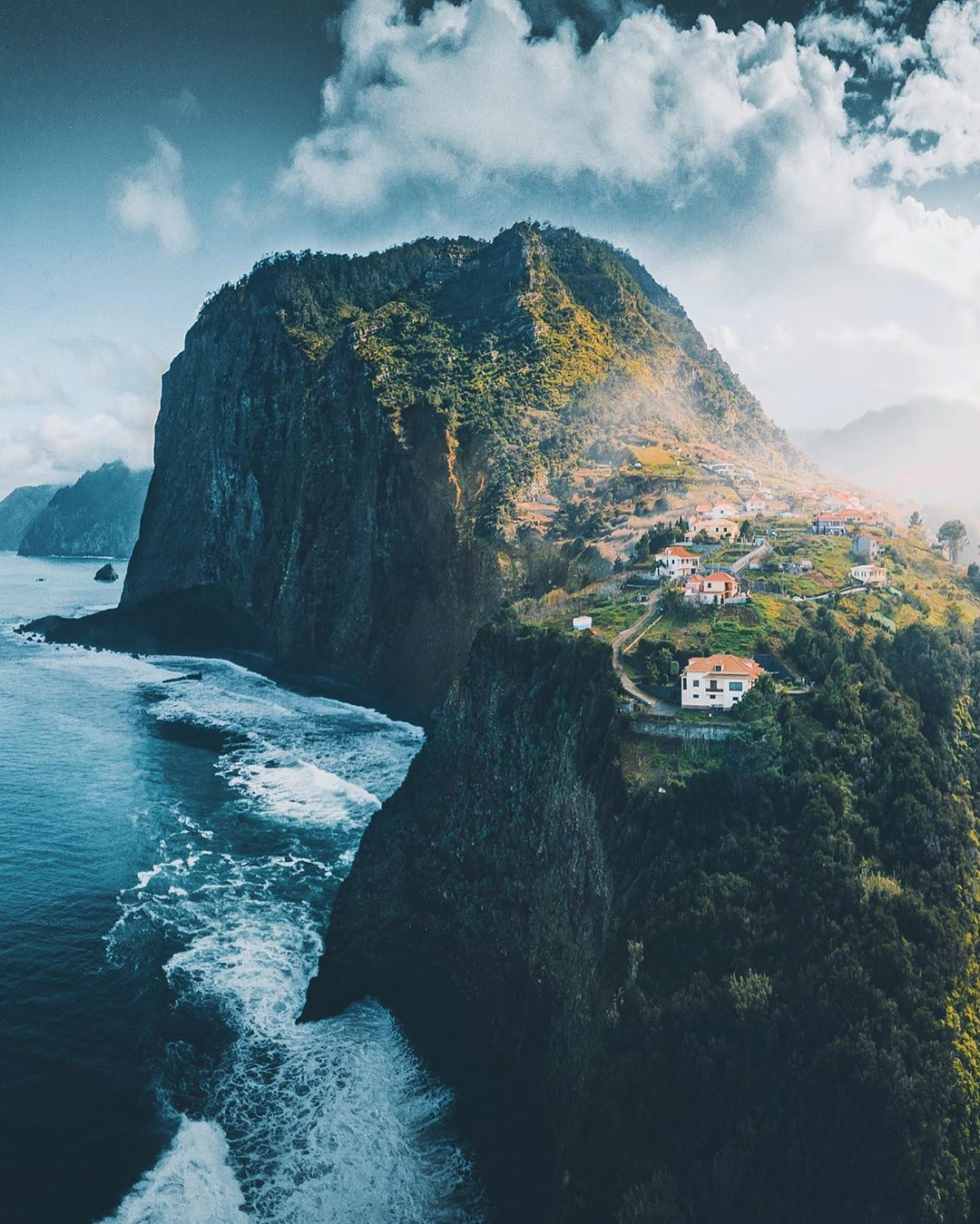 houses close to a sharp cliff in madeira