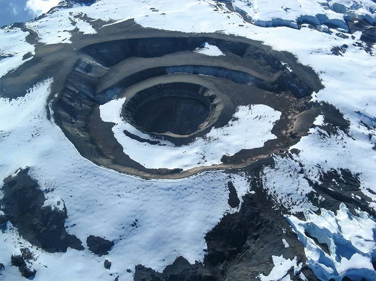 aerial photography of the top of a snowy mountain