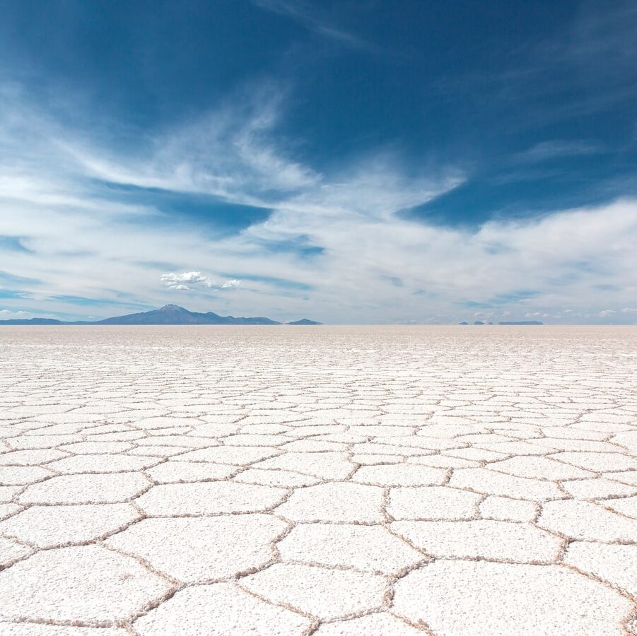 dry soil under white clouds and blue sky