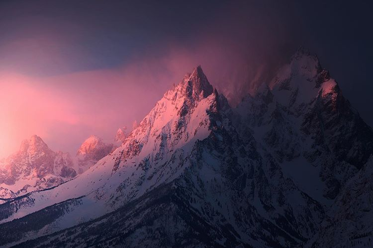 mountain covered with snow under pink light