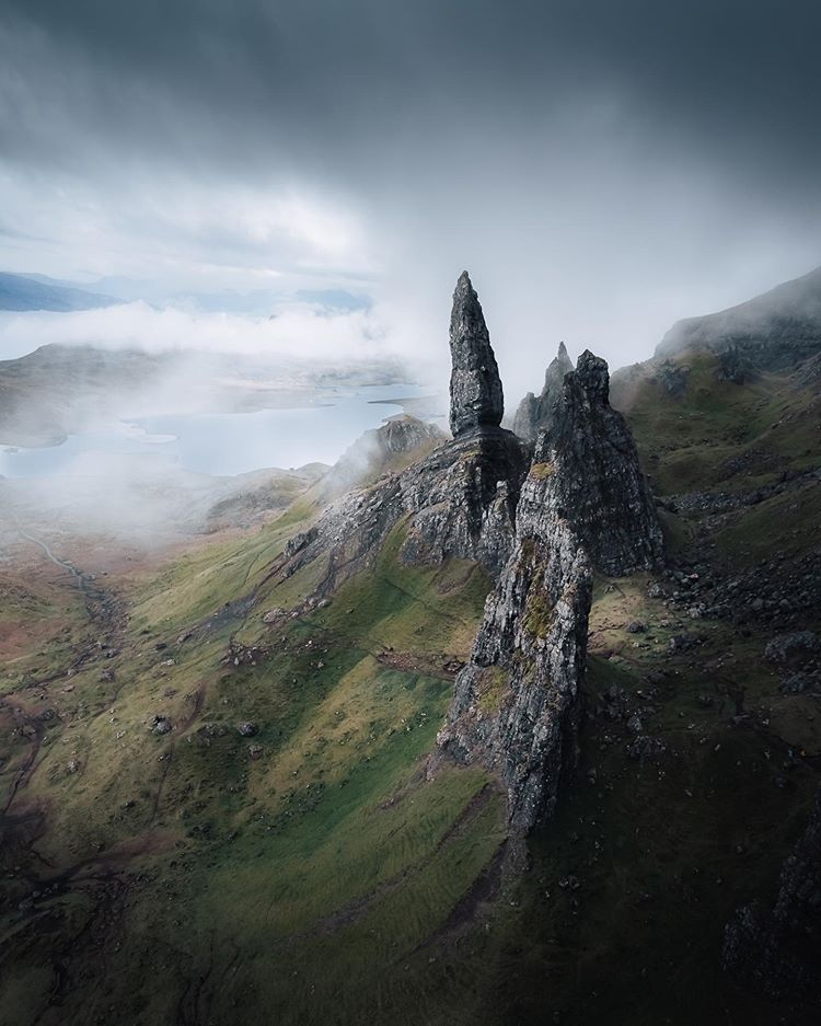 sharp rock formation in a misty atmosphere