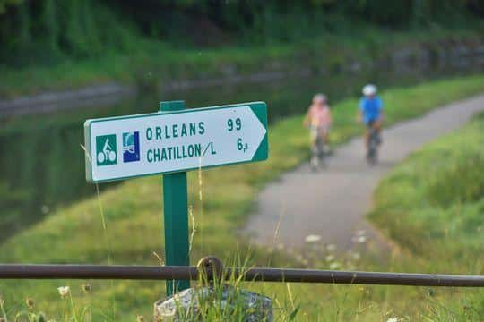 white and green sign indicating french cities