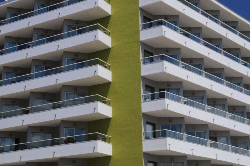 lime and white hotel with balconies