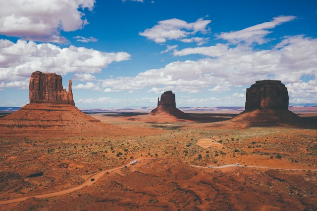 three rock monoliths in monument valley photo