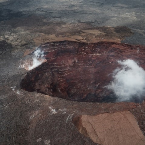 brown and white stone fragment of kilauea active volcano