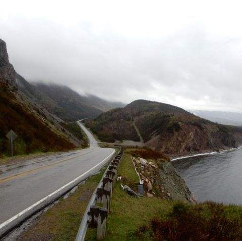gray concrete road near body of water in cape breton island