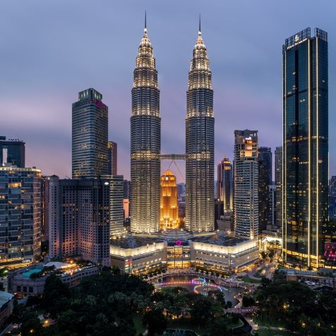 high rise building during night time in cheap malaysia