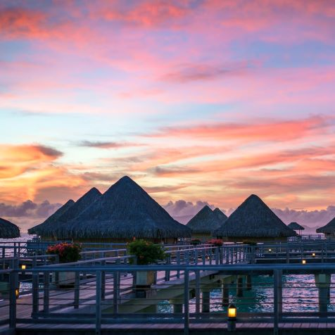 luxurious water houses at sunset in famous bora bora