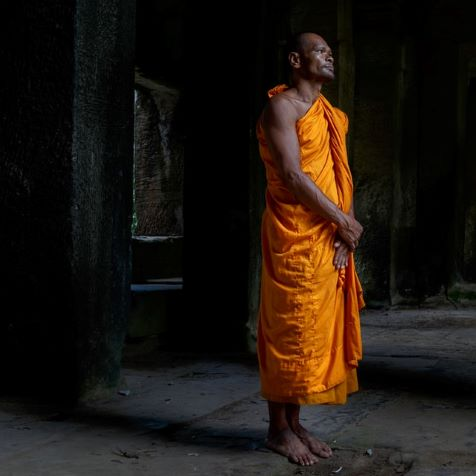 man standing barefoot in cheap cambodia
