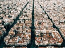 why is spain so cheap buildings with red roofs
